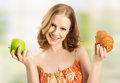 Woman bun apple choose healthy unhealthy food Stock Photos