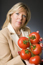Woman with bunch of fresh ripe tomatoes Royalty Free Stock Photo