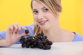 Woman with bunch of grapes Royalty Free Stock Photo