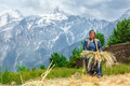 Woman with a bunch of wheat smiling mature in himalaya mountains Stock Images