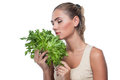 Woman with  bundle herbs (salat) Stock Photo