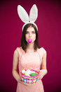 Woman in bunny ears holding Easter egg basket Royalty Free Stock Photo