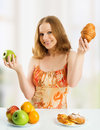 Woman buns fruits choose healthy unhealthy food Royalty Free Stock Image