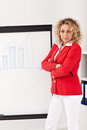 Woman business outfit making presentation flipchart Royalty Free Stock Photo
