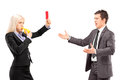 Woman in business suit showing a red card and blowing a whistle to men isolated on white background Royalty Free Stock Images