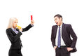 Woman in business suit showing a red card to an angry man in a s men isolated on white background Stock Images