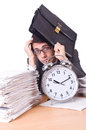 Woman businessman with giant alarm clock Royalty Free Stock Image
