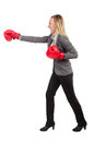 Woman businesswoman with boxing gloves on white Stock Image