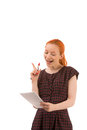 Woman busy giving a presentation pretty young redhead reading from notebook and raising her finger to emphasise point isolated Royalty Free Stock Image