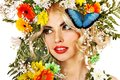 Woman with butterfly and flower. Stock Photography