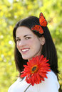 Woman with Butterfly and Red Flowers in Park Stock Photography