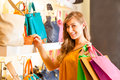 Woman buying a bag in mall Royalty Free Stock Photo
