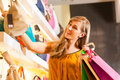Woman buying a bag in mall Stock Image