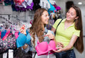 Woman buying brassiere young attractive women a in clothing store Royalty Free Stock Photo