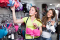 Woman buying brassiere young attractive women the at clothing store Stock Images