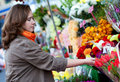 Woman buying flowers at market Royalty Free Stock Image