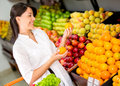 Woman buying fresh fruit Stock Photography