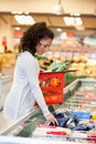 Woman Buying Frozed Food in Supermarket Royalty Free Stock Image
