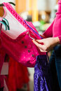 Woman is buying Tracht or dirndl in a shop Royalty Free Stock Photography