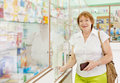 Woman buys drugs at pharmacy mature the Stock Photo