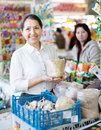 Woman buys the seeds in bag on market Stock Image