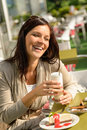 Woman at cafe bar holding latte drink Royalty Free Stock Images
