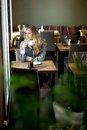 Woman in cafe day dreaming young attractive sitting daydreaming over coffee Royalty Free Stock Photos