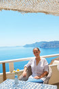 Woman in cafe in Santorini Royalty Free Stock Photo