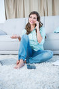 Woman calling while calculating bills with laptop at home in the living room Royalty Free Stock Photos