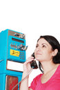Woman calling from public phone Royalty Free Stock Photography