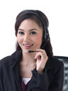 A woman calls with headset Royalty Free Stock Photo