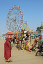 Woman camels and ferris wheels at Pushkar camel fair Stock Images