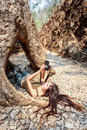 Woman with camera lie down in the tree s hole hellfire pass museum kanchanaburi thailand Stock Images