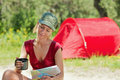 Woman camping Stock Photo
