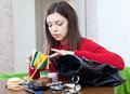 Woman can not finding anything in her purse young Stock Photography