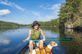Woman canoeing on lake Royalty Free Stock Photo
