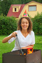 Woman in cap near  brazier, happy birthday Royalty Free Stock Image