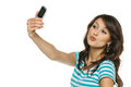 Woman capturing photo of herself on cellphone Stock Photo