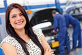 Woman at a car garage Royalty Free Stock Photo