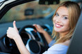 Woman in car giving thumbs up Royalty Free Stock Photo