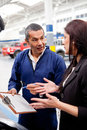 Woman at the car mechanic Stock Photography