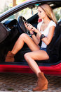 Woman in car with mobile phone Royalty Free Stock Photos