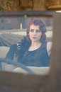Woman in a car - retro style Royalty Free Stock Photo