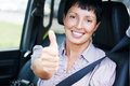 Woman in a car smiling senior Stock Photos