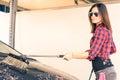 Woman at car wash station young modern Royalty Free Stock Photos