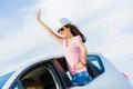 Woman in car young pretty leaning out of window Stock Photography