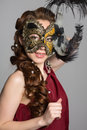 Woman in carnival mask on gray background Stock Photos