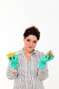 Woman in carrier cleaning a mug Royalty Free Stock Photo
