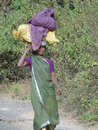 Woman carries goods on her head Royalty Free Stock Image