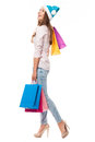 Woman carrying bags with christmas shoppings young over white background Stock Photo